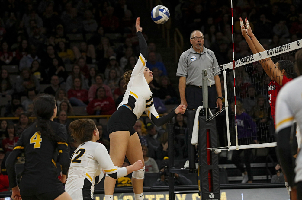 Iowa's Blythe Rients (11) goes up for a shot during the third set of their match against Nebraska at Carver-Hawkeye Arena in Iowa City on Saturday, Nov 9, 2019. (Stephen Mally/hawkeyesports.com)