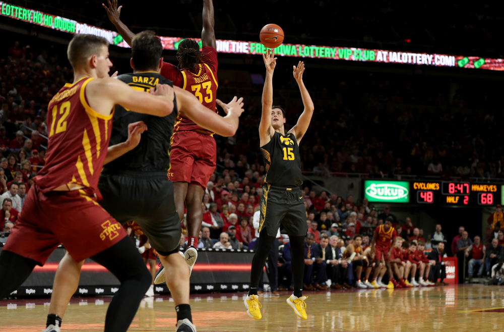 Iowa Hawkeyes forward Ryan Kriener (15) knocks down a three point basket against the Iowa State Cyclones Thursday, December 12, 2019 at Hilton Coliseum in Ames, Iowa(Brian Ray/hawkeyesports.com)
