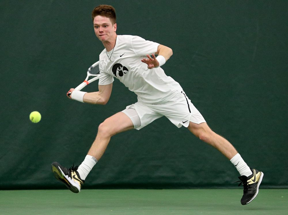 Iowa's Jason Kerst returns a shot during his singles match at the Hawkeye Tennis and Recreation Complex in Iowa City on Sunday, February 16, 2020. (Stephen Mally/hawkeyesports.com)