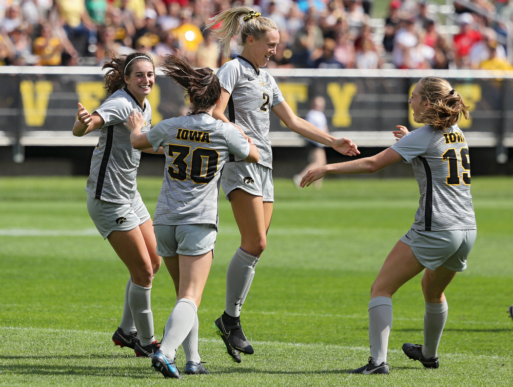 Iowa forward Kaleigh Haus (4), forward Devin Burns (30), midfielder Hailey Rydberg (2), and forward Jenny Cape (19) celebrates after Haus scored a goal during the first half of their match at the Iowa Soccer Complex in Iowa City on Sunday, Sep 1, 2019. (Stephen Mally/hawkeyesports.com)