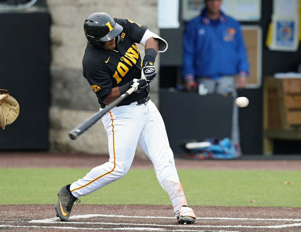 Iowa infielder Izaya Fullard (20) drives a pitch for a hit during the eighth inning of their college baseball game at Duane Banks Field in Iowa City on Tuesday, March 10, 2020. (Stephen Mally/hawkeyesports.com)