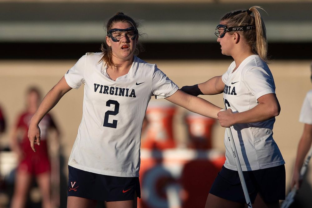 STANFORD, California - FEBRUARY 14:  Virginia Cavaliers midfield Sammy Mueller (2) is congratulated by midfield Ashlyn McGovern (16) after scoring a goal against the Stanford Cardinal during the second half at Cagan Stadium on February 14, 2020 in Stanford, California. The Virginia Cavaliers defeated the Stanford Cardinal 12-11. (Photo by Jason O. Watson)
