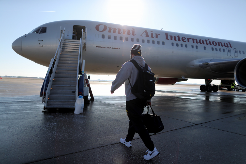 Iowa Hawkeyes defensive lineman Brady Reiff (91) boards the team plane at the Eastern Iowa Airport Saturday, December 21, 2019 on the way to San Diego, CA for the Holiday Bowl. (Brian Ray/hawkeyesports.com)