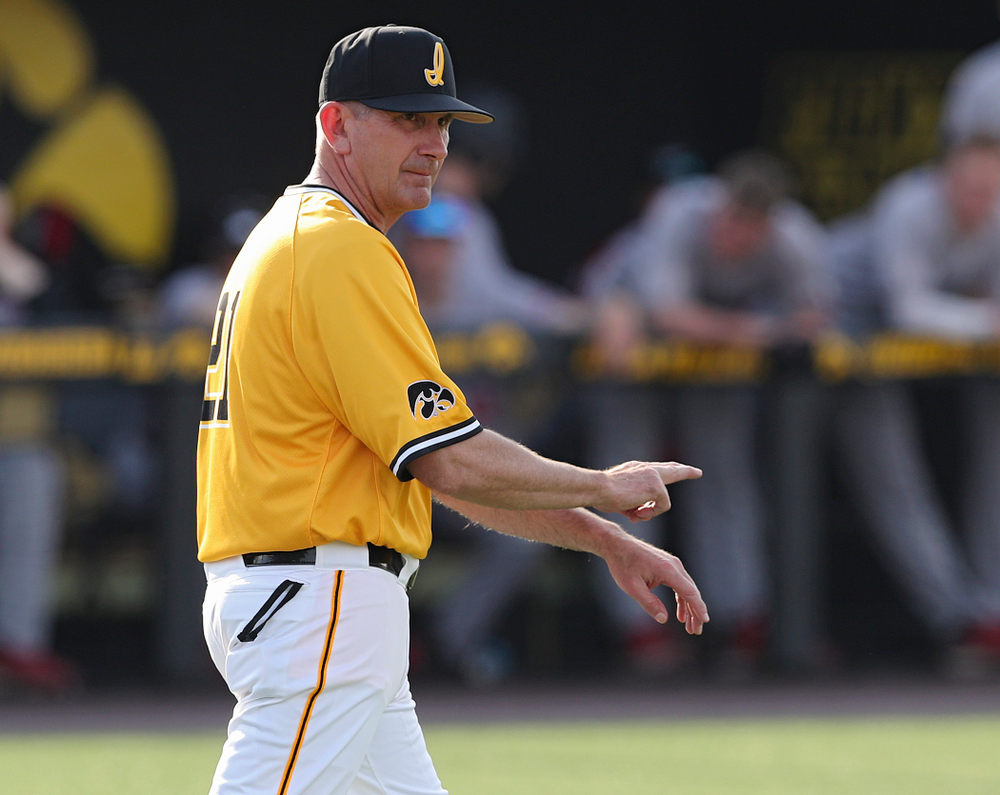 Iowa Hawkeyes head coach Rick Heller signals to the bullpen during the fourth inning of their game against Northern Illinois at Duane Banks Field in Iowa City on Tuesday, Apr. 16, 2019. (Stephen Mally/hawkeyesports.com)