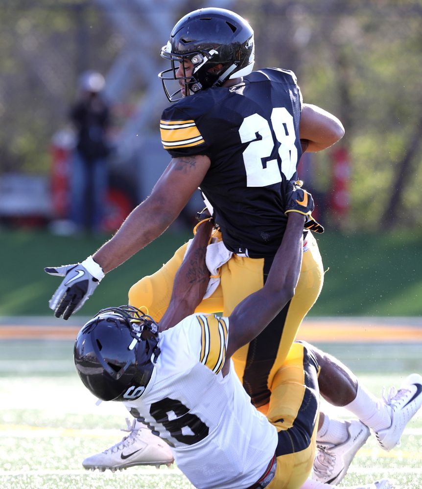Iowa Hawkeyes running back Toren Young (28) and defensive back Terry Roberts (16) during the teamÕs final spring practice Friday, April 26, 2019 at the Kenyon Football Practice Facility. (Brian Ray/hawkeyesports.com)