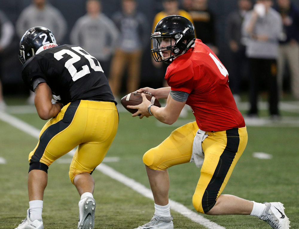 Toren Young, Nate Stanley -- University of Iowa spring football practice No. 6 on March 31, 2018, in Iowa City, Iowa. (Darren Miller/hawkeyesports.com)