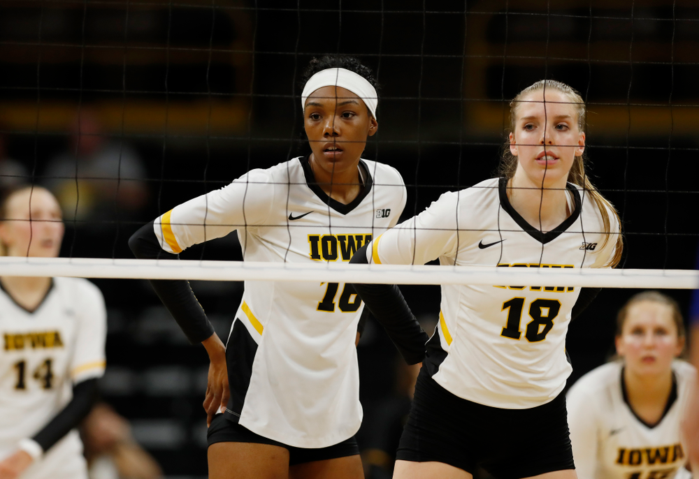 Iowa Hawkeyes outside hitter Taylor Louis (16) and middle blocker Hannah Clayton (18) against Eastern Illinois Sunday, September 9, 2018 at Carver-Hawkeye Arena. (Brian Ray/hawkeyesports.com)