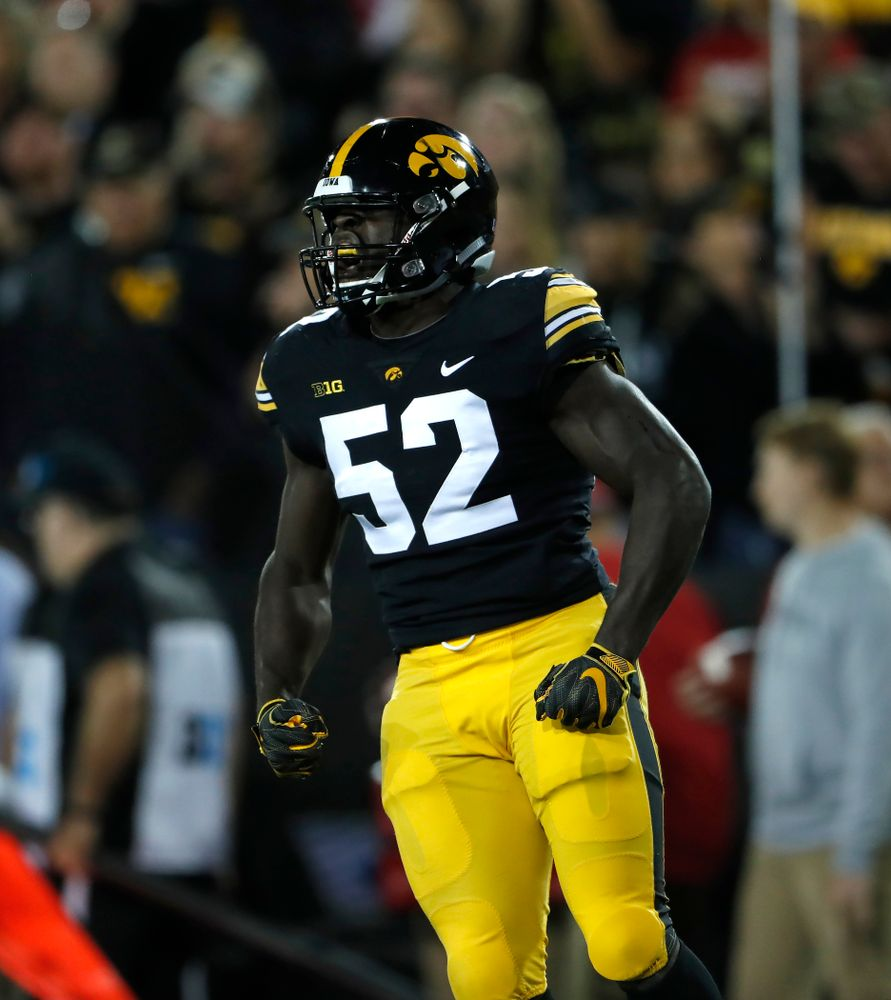 Iowa Hawkeyes linebacker Amani Jones (52) reacts after making a stop against the Wisconsin Badgers Saturday, September 22, 2018 at Kinnick Stadium. (Brian Ray/hawkeyesports.com)