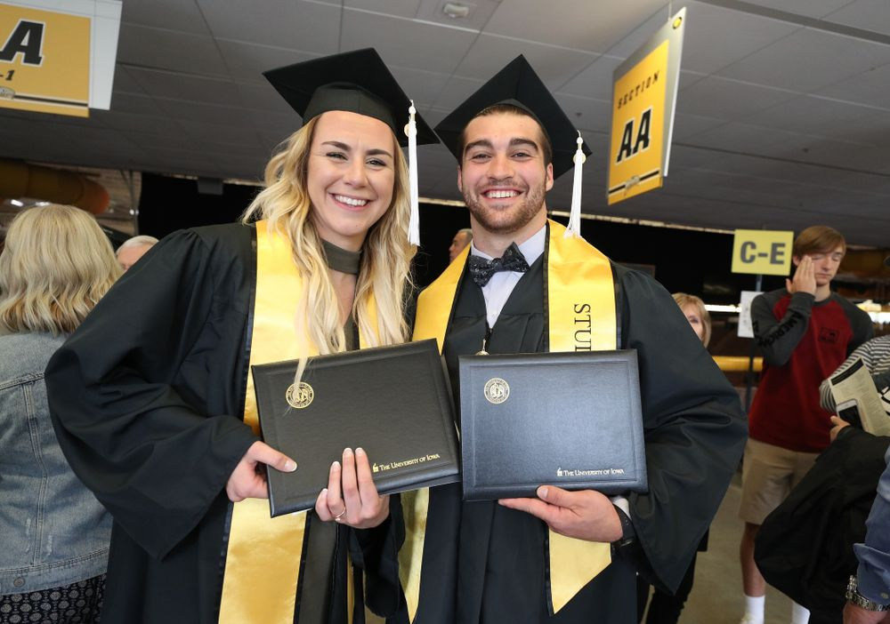 Iowa WomenÕs BasketballÕs Hannah Stewart and Iowa FootballÕs Garret Jansen during the College of Liberal Arts and Sciences spring commencement Saturday, May 11, 2019 at Carver-Hawkeye Arena. (Brian Ray/hawkeyesports.com)