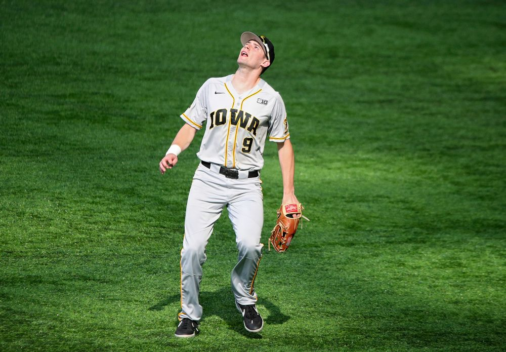 Iowa Hawkeyes outfielder Ben Norman (9) tracks down a fly ball for an out during the second inning of their CambriaCollegeClassic game at U.S. Bank Stadium in Minneapolis, Minn. on Friday, February 28, 2020. (Stephen Mally/hawkeyesports.com)