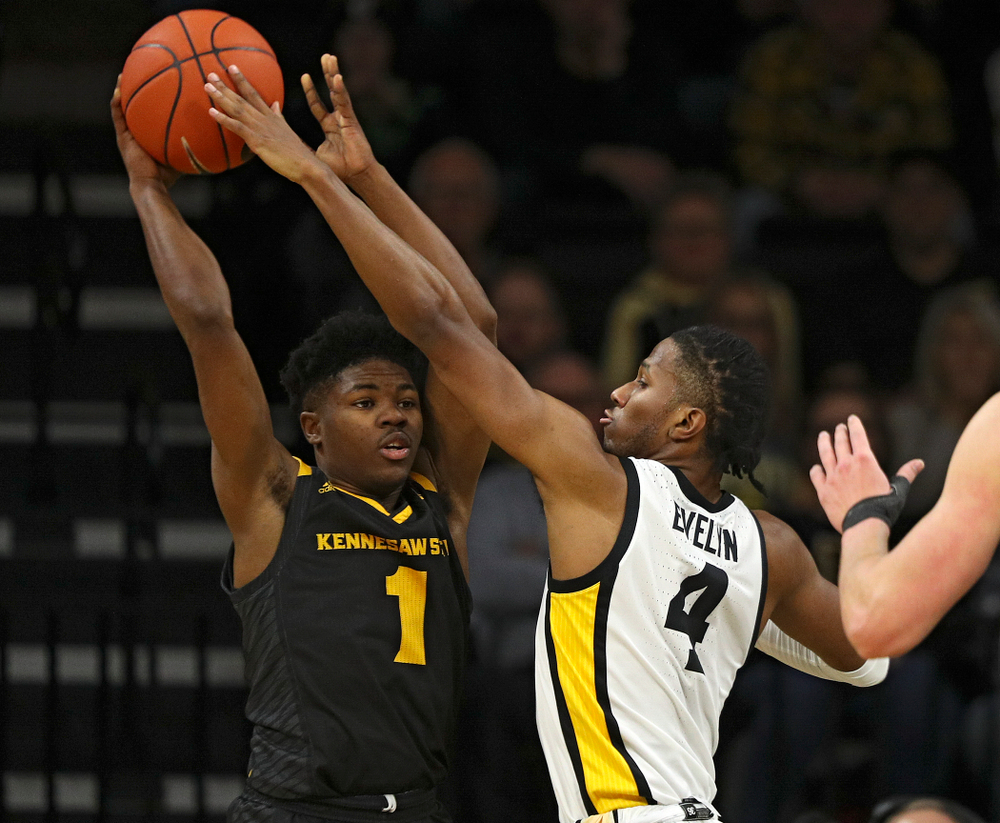 Iowa Hawkeyes guard Bakari Evelyn (4) gets his hands on a pass by Kennesaw State Owls guard Terrell Burden (1) during the first half of their their game at Carver-Hawkeye Arena in Iowa City on Sunday, December 29, 2019. (Stephen Mally/hawkeyesports.com)