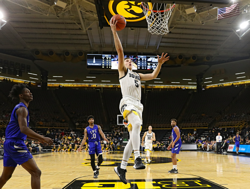 Iowa Hawkeyes guard CJ Fredrick (5) makes a basket during the second half of their exhibition game against Lindsey Wilson College at Carver-Hawkeye Arena in Iowa City on Monday, Nov 4, 2019. (Stephen Mally/hawkeyesports.com)
