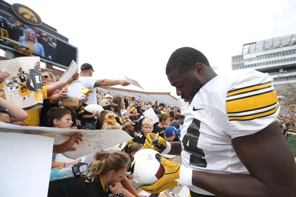 Iowa's Daraun McKinney signs autographs at the Kids Day at Kinnick Stadium on Saturday, August 10, 2019  (Lily Smith/hawkeyesports.com)