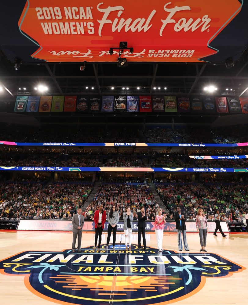 Iowa Hawkeyes forward Megan Gustafson (10) and Iowa State's Bridget Carleton are introduced with Naismith Starting 5 namesakes during a timeout in the second half of the National Semi-Final between Baylor and Oregon Friday, April 5, 2019 at Amalie Arena in Tampa, FL. (Brian Ray/hawkeyesports.com)