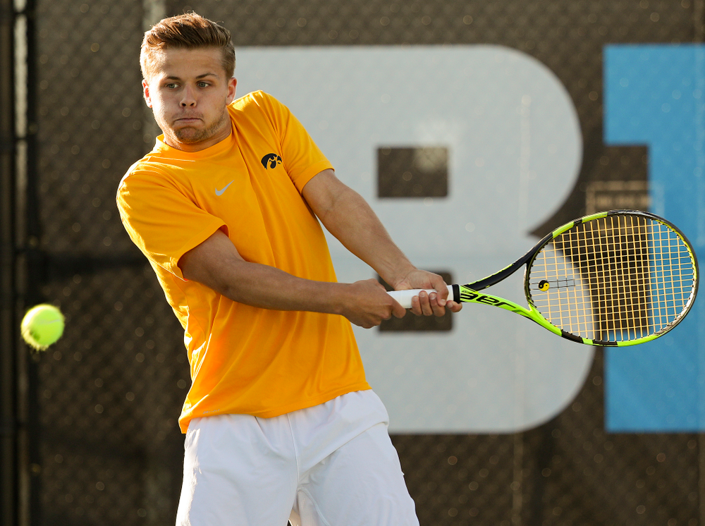 Iowa's Will Davies during their doubles match again Michigan State at the Hawkeye Tennis and Recreation Complex in Iowa City on Friday, Apr. 19, 2019. (Stephen Mally/hawkeyesports.com)