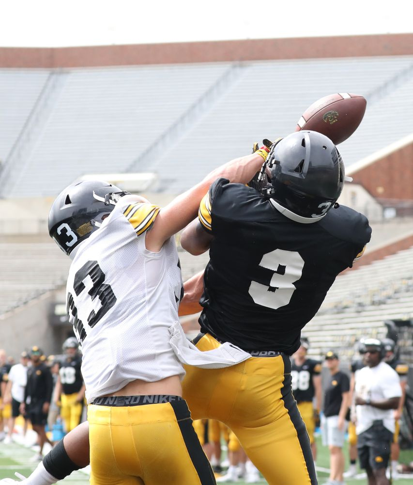 DB Riley Moss (33) breaks up a pass intended for WR Tyrone Tracy (3)
