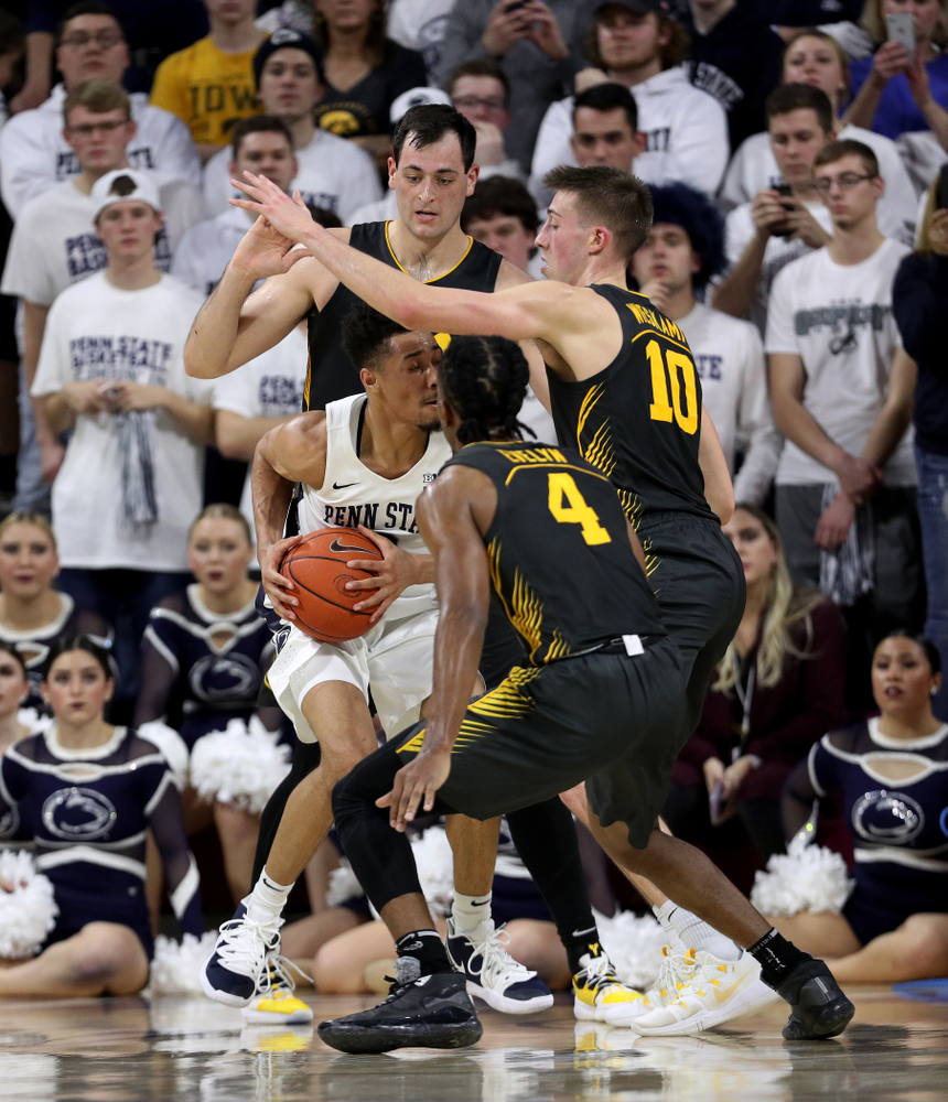 Iowa Hawkeyes forward Ryan Kriener (15), guard Joe Wieskamp (10), and guard Bakari Evelyn (4) against Penn State Saturday, January 4, 2020 at the Palestra in Philadelphia. (Brian Ray/hawkeyesports.com)