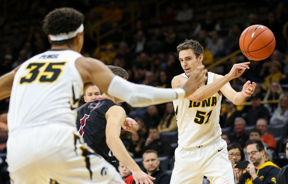 Iowa Hawkeyes forward Nicholas Baer (51) makes an entry pass to Iowa Hawkeyes forward Cordell Pemsl (35) during a game against Guilford College at Carver-Hawkeye Arena on November 4, 2018. (Tork Mason/hawkeyesports.com)