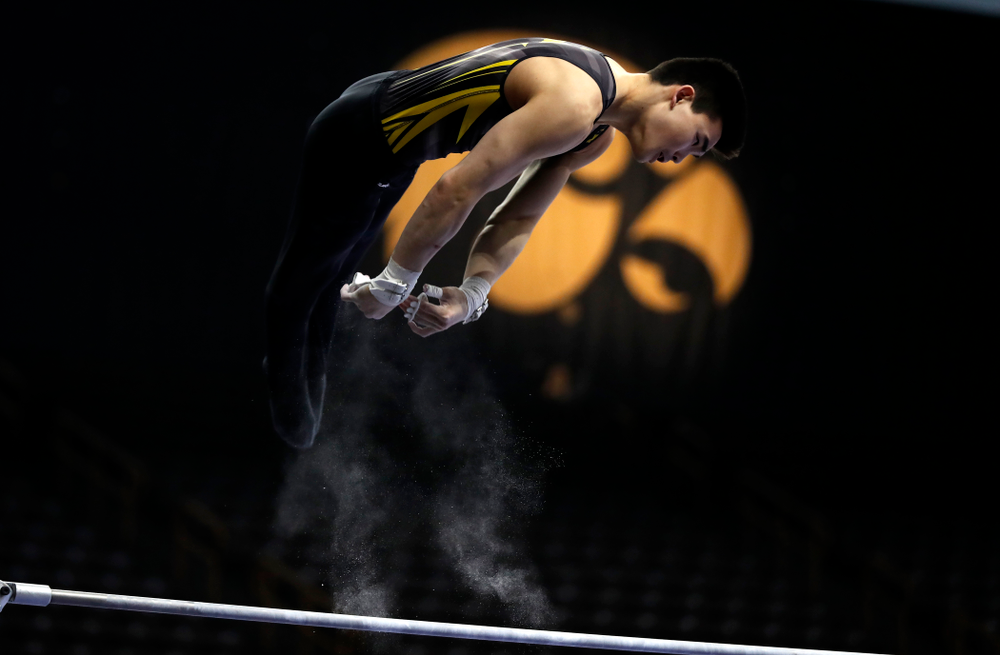 Addison Chung competes on the high bar against Minnesota and Air Force
