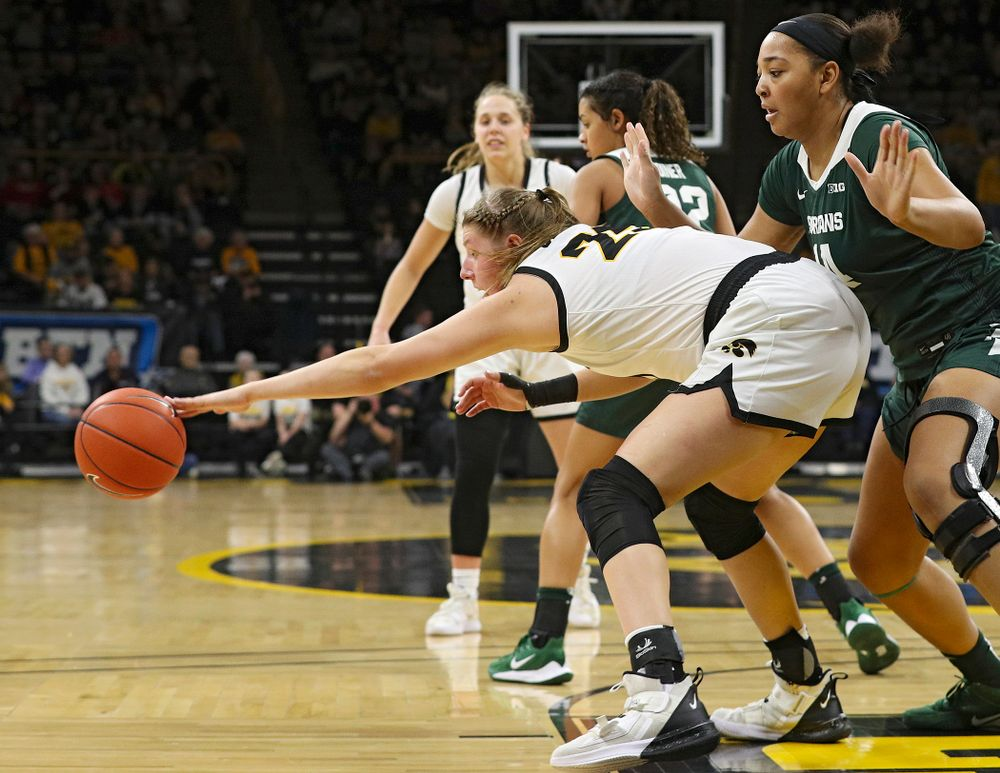 Iowa Hawkeyes forward Monika Czinano (25) grabs a ball during the second quarter of their game at Carver-Hawkeye Arena in Iowa City on Sunday, January 26, 2020. (Stephen Mally/hawkeyesports.com)