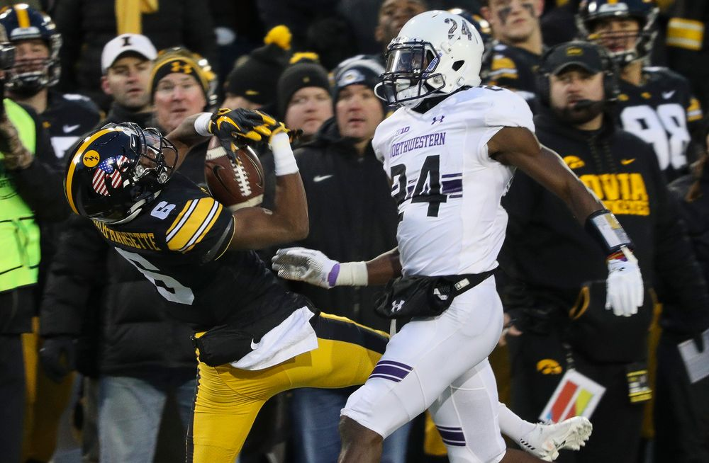 Iowa Hawkeyes wide receiver Ihmir Smith-Marsette (6) makes a catch along the sideline during a game against Northwestern at Kinnick Stadium on November 10, 2018. (Tork Mason/hawkeyesports.com)