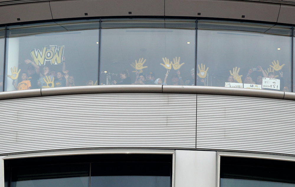 People in the University of Iowa Stead Family Children's Hospital wave back between the first and second quarter of their game at Kinnick Stadium in Iowa City on Saturday, Sep 28, 2019. (Stephen Mally/hawkeyesports.com)