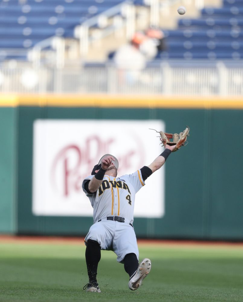 Iowa Hawkeyes infielder Mitchell Boe (4) catches a fly ball against the Indiana Hoosiers in the first round of the Big Ten Baseball Tournament Wednesday, May 22, 2019 at TD Ameritrade Park in Omaha, Neb. (Brian Ray/hawkeyesports.com)