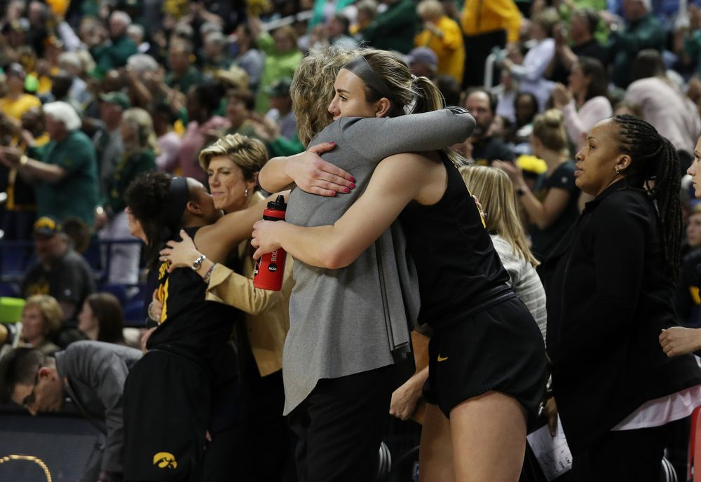 Iowa Hawkeyes forward Hannah Stewart (21) hugs head coach Lisa Bluder at the end of the regional final against the Baylor Lady Bears in the 2019 NCAA Women's College Basketball Tournament Monday, April 1, 2019 at Greensboro Coliseum in Greensboro, NC.(Brian Ray/hawkeyesports.com)