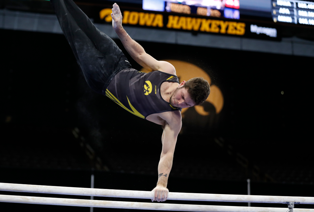 Rogelio Vazquez competes on the bars against Minnesota and Air Force