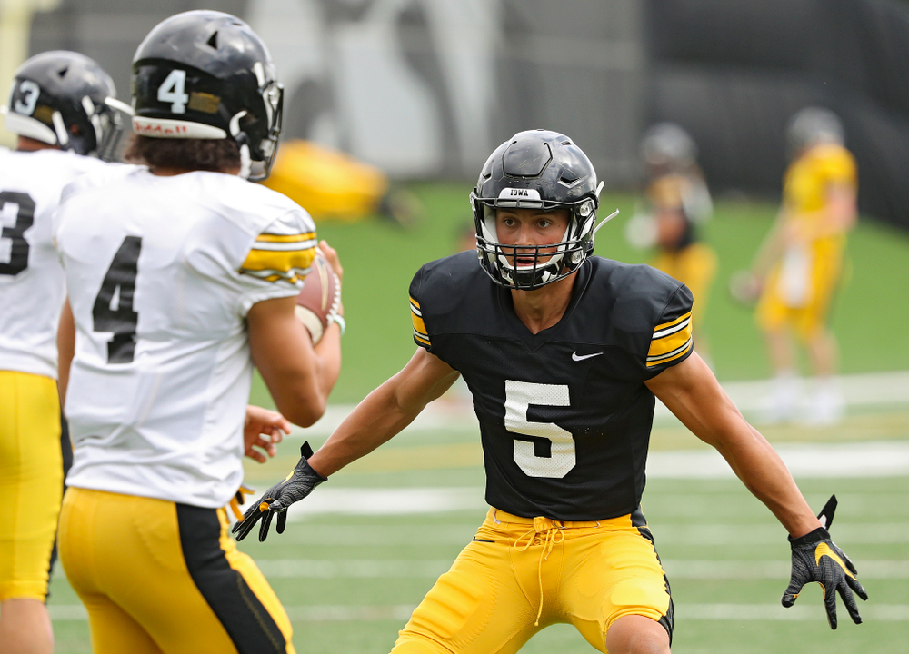 Iowa Hawkeyes wide receiver Oliver Martin (5) eyes defensive back Dane Belton (4) as they run a drill during Fall Camp Practice No. 10 at the Hansen Football Performance Center in Iowa City on Tuesday, Aug 13, 2019. (Stephen Mally/hawkeyesports.com)