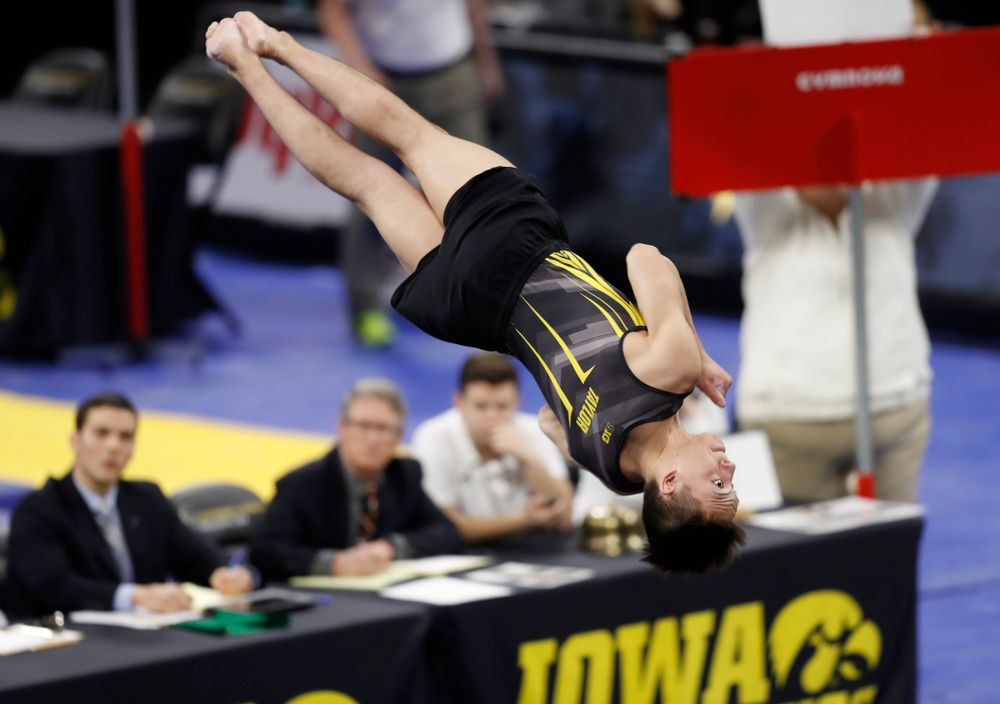 Iowa's Kulani Taylor competes on the floor