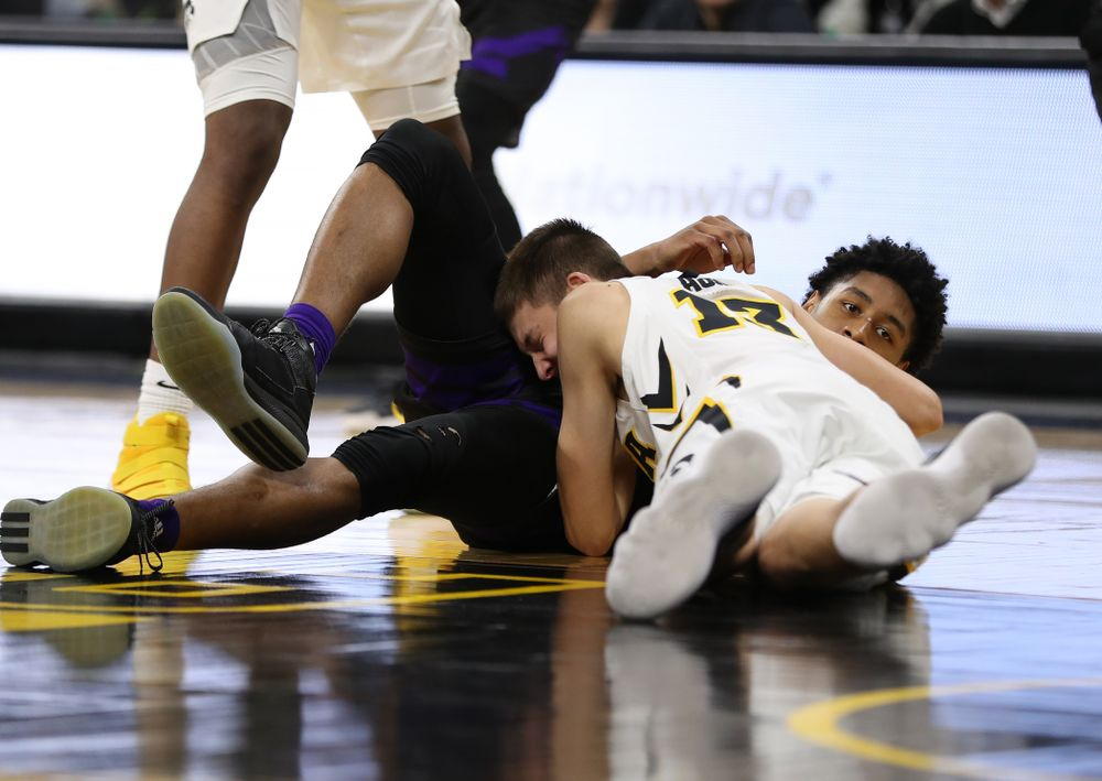 Iowa Hawkeyes guard Austin Ash (13) against the Western Carolina Catamounts Tuesday, December 18, 2018 at Carver-Hawkeye Arena. (Brian Ray/hawkeyesports.com)