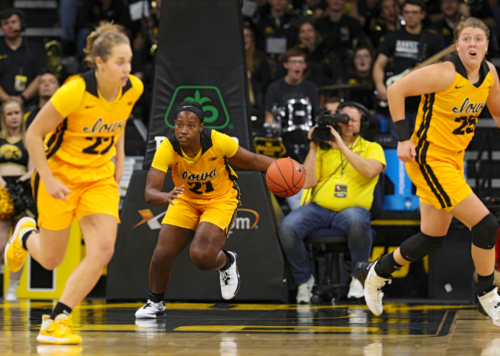 Iowa guard Zion Sanders (21) brings the ball down the court as guard Kathleen Doyle (22) and forward/center Monika Czinano (25) run during the third quarter of their game against Winona State at Carver-Hawkeye Arena in Iowa City on Sunday, Nov 3, 2019. (Stephen Mally/hawkeyesports.com)