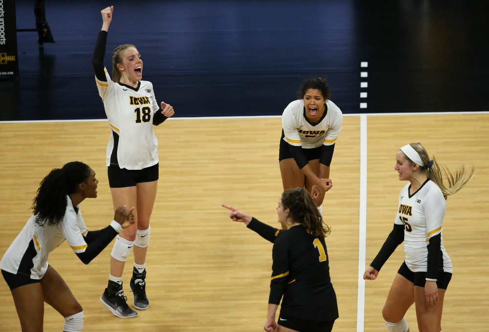 Iowa Hawkeyes middle blocker Hannah Clayton (18) and Iowa Hawkeyes setter Brie Orr (7) react after winning a point during a game against Purdue at Carver-Hawkeye Arena on October 13, 2018. (Tork Mason/hawkeyesports.com)