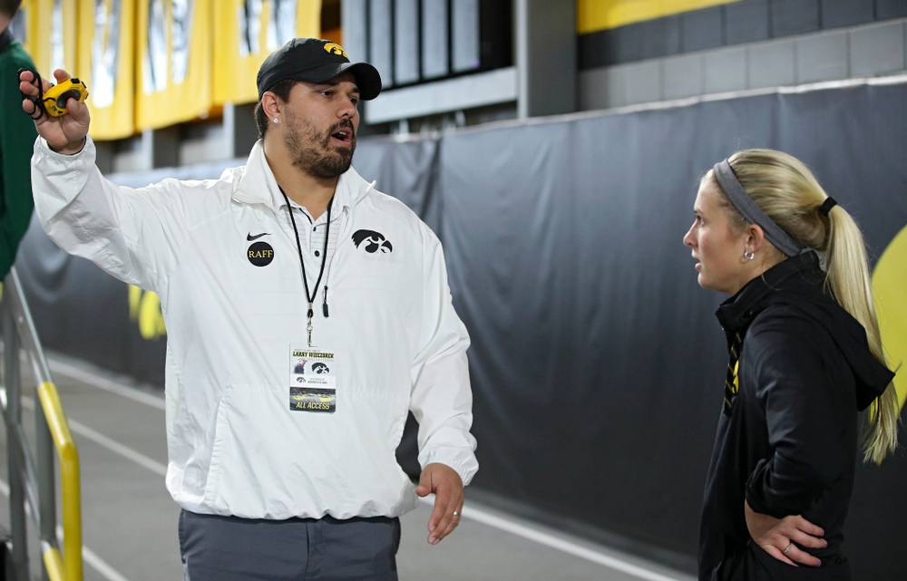 Iowa assistant coach/recruiting coordinator Jason Wakenight (from left) talks with Aly Weum during the Larry Wieczorek Invitational at the Recreation Building in Iowa City on Saturday, January 18, 2020. (Stephen Mally/hawkeyesports.com)