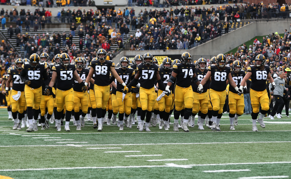 The Iowa Hawkeyes swarm onto the field before their game against the Nebraska Cornhuskers Friday, November 23, 2018 at Kinnick Stadium. (Brian Ray/hawkeyesports.com)