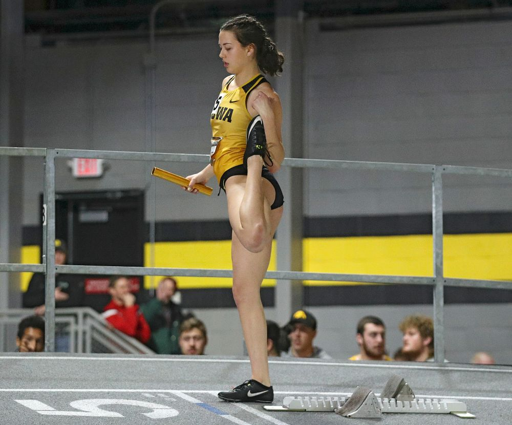 Iowa's Jenny Kimbro stretches before the women's 1600 meter relay premier event during the Larry Wieczorek Invitational at the Recreation Building in Iowa City on Saturday, January 18, 2020. (Stephen Mally/hawkeyesports.com)