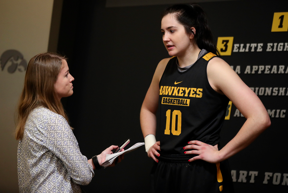 Iowa Hawkeyes forward Megan Gustafson (10) talks with a reporter during media availability before their next game in the 2019 NCAA Women's Basketball Tournament at Carver Hawkeye Arena in Iowa City on Saturday, Mar. 23, 2019. (Stephen Mally for hawkeyesports.com)