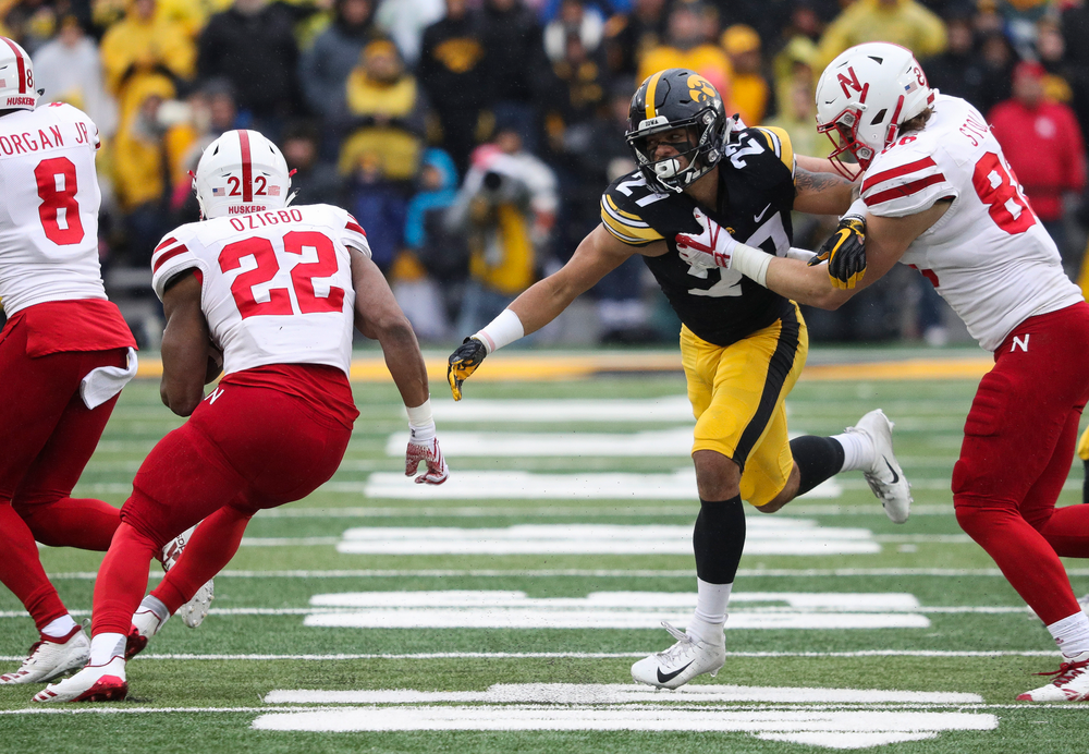 Iowa Hawkeyes defensive back Amani Hooker (27) fights off a block during a game against Nebraska at Kinnick Stadium on November 23, 2018. (Tork Mason/hawkeyesports.com)