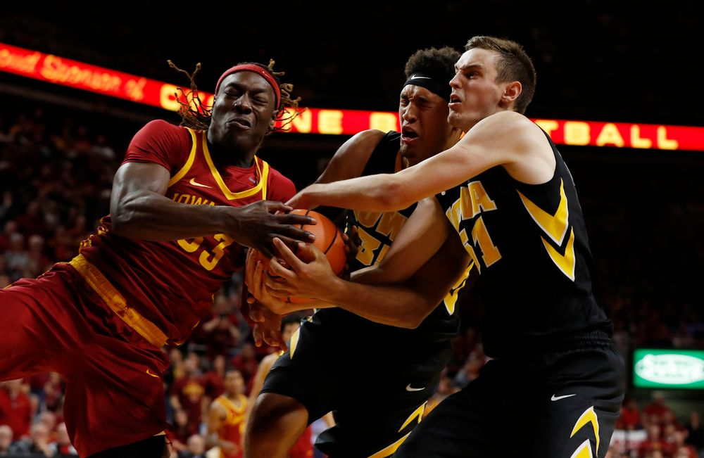 Iowa Hawkeyes forward Cordell Pemsl (35) and forward Nicholas Baer (51)