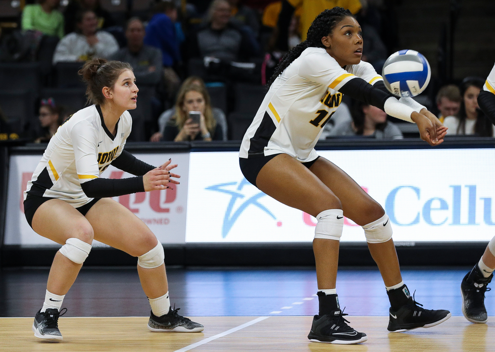 Iowa Hawkeyes outside hitter Taylor Louis (16) bumps the ball during a match against Maryland at Carver-Hawkeye Arena on November 23, 2018. (Tork Mason/hawkeyesports.com)