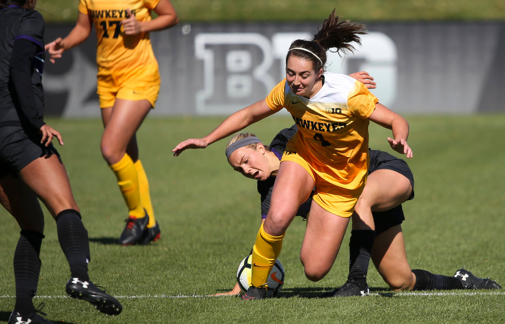 Iowa Hawkeyes forward Kaleigh Haus (4) is fouled during a game against Northwestern at the Iowa Soccer Complex on October 21, 2018. (Tork Mason/hawkeyesports.com)