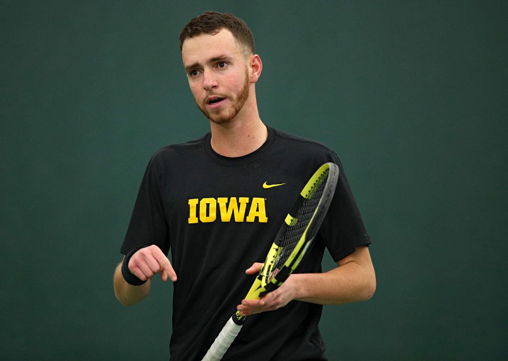 Iowa's Kareem Allaf points to the court as he celebrates a point during his singles match at the Hawkeye Tennis and Recreation Complex in Iowa City on Friday, March 6, 2020. (Stephen Mally/hawkeyesports.com)