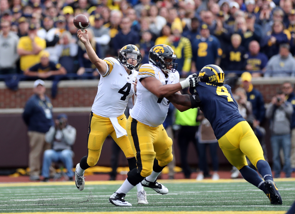 Iowa Hawkeyes quarterback Nate Stanley (4) against the Michigan Wolverines Saturday, October 5, 2019 at Michigan Stadium in Ann Arbor, MI. (Brian Ray/hawkeyesports.com)