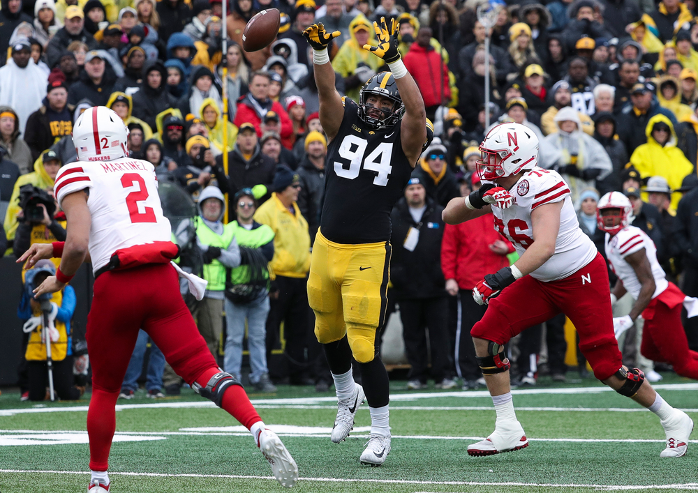 Iowa Hawkeyes defensive end A.J. Epenesa (94) bats down a pass during a game against Nebraska at Kinnick Stadium on November 23, 2018. (Tork Mason/hawkeyesports.com)