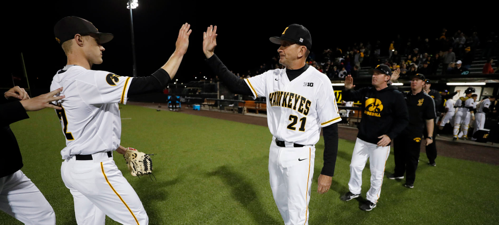Iowa Hawkeyes pitcher Zach Daniels (2) and head coach Rick Heller against the Michigan Wolverines Friday, April 27, 2018 at Duane Banks Field in Iowa City. (Brian Ray/hawkeyesports.com)