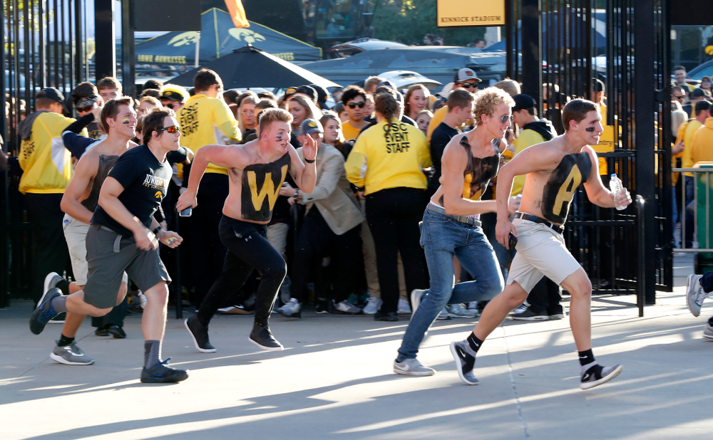 Students run to get seats before the Iowa Hawkeyes game against the Wisconsin Badgers Saturday, September 22, 2018 at Kinnick Stadium. (Brian Ray/hawkeyesports.com)