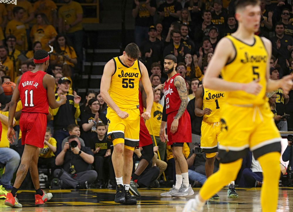 Iowa Hawkeyes center Luka Garza (55) flexes after making a basket while being fouled during the first half of their game at Carver-Hawkeye Arena in Iowa City on Saturday, February 8, 2020. (Stephen Mally/hawkeyesports.com)