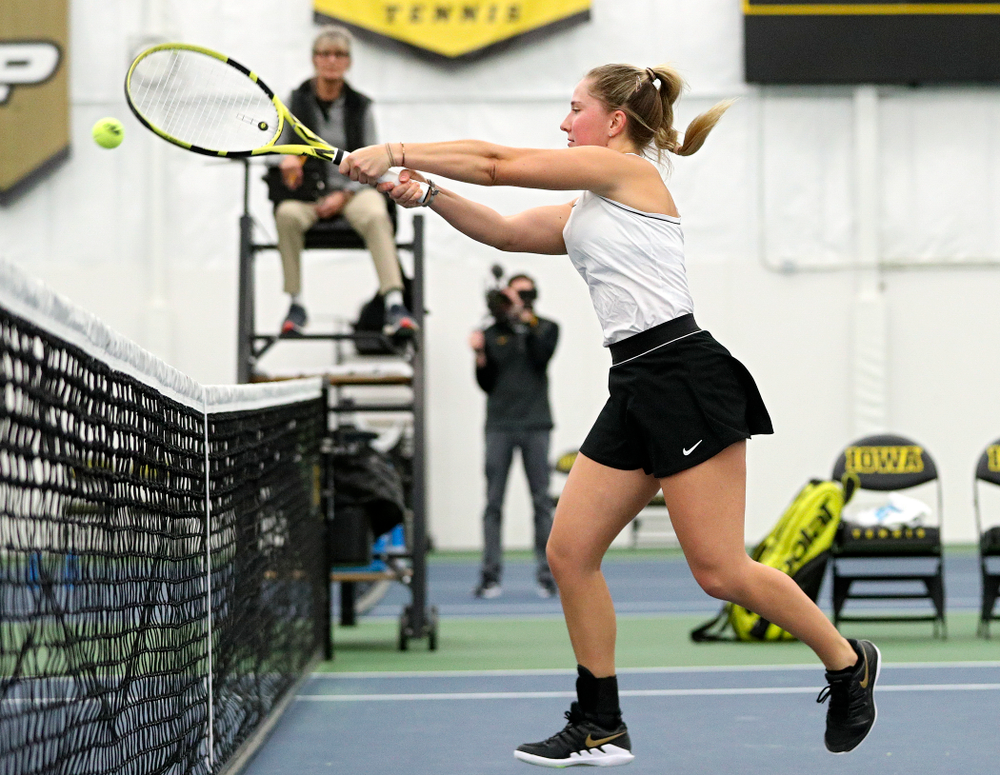Iowa's Danielle Burich returns a shot at the net during her doubles match at the Hawkeye Tennis and Recreation Complex in Iowa City on Sunday, February 16, 2020. (Stephen Mally/hawkeyesports.com)