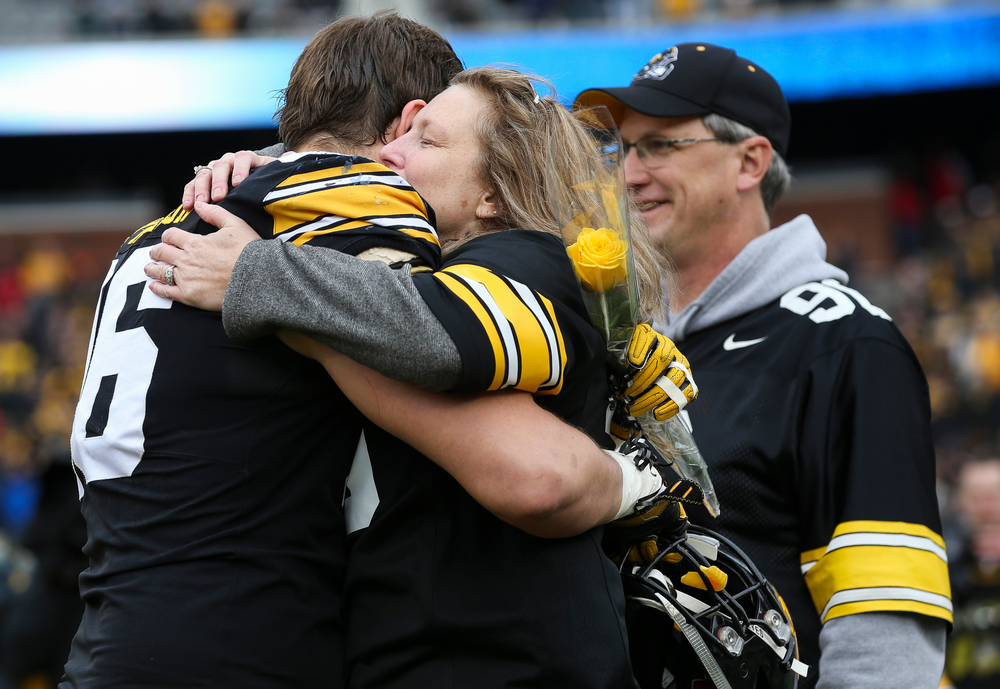 Iowa Hawkeyes defensive lineman Matt Nelson (96) gets a hug from his mother during Senior Day ceremonies before a game against Nebraska at Kinnick Stadium on November 23, 2018. (Tork Mason/hawkeyesports.com)